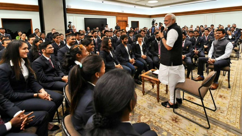 Prime Minister Narendra Modi interacts with the medal winners of 18th Asain Games